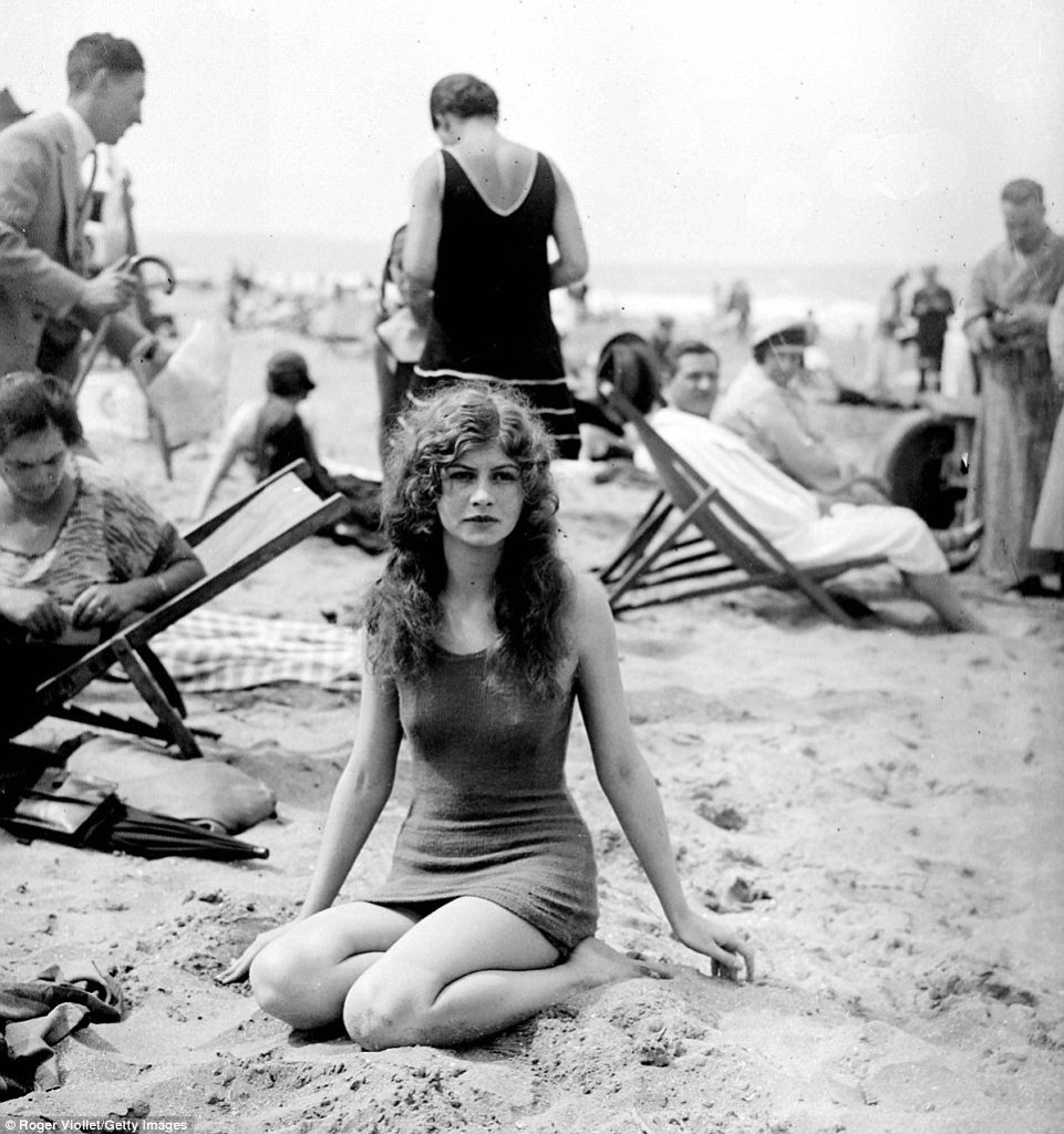 thoughful woman on beach normandy 1920s